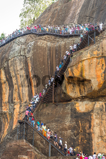 People climbed on external stairway from the Lion Gate to the palace on top