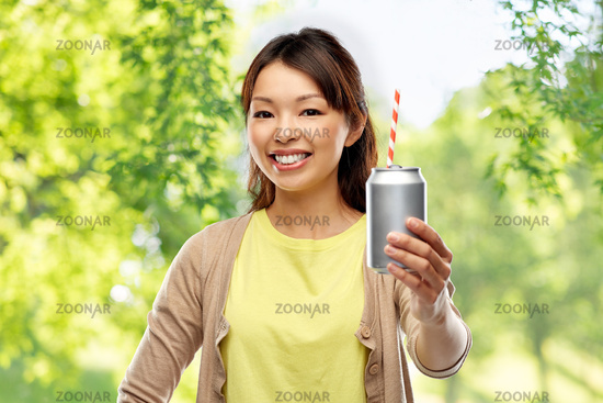 asian woman with can drink over natural background