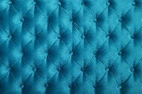 Teal blue capitone tufted fabric upholstery texture
