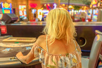 Woman gambling at blackjack table