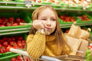 Bored Kid in Supermarket