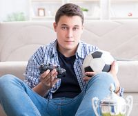 Young man playing computer games at home