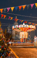 Moscow, Russia, 05 December 2017: Christmas in Moscow. Bright Christmas carousel in the capital of Russia. Christmas market on red square. Kremlin. St. Basil