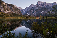 Autumn evening Alps mountain lake with clear transparent water and reflections. Almsee lake, Upper Austria.