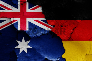 flags of Australia and Germany painted on cracked wall