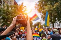 Correspondent takes photo during the Gay Pride parade