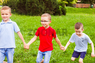 Boys team playing outdoors game in sunny day