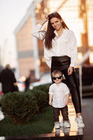Young girl and child in white shirts