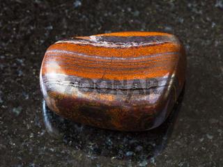 polished Jaspillite stone on black