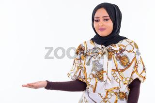Young beautiful African Muslim woman showing something
