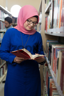 beautiful female middle eastern  womabn at library