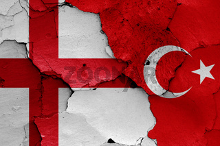 flags of England and Turkey painted on cracked wall