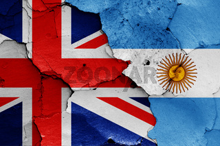flags of UK and Argentina painted on cracked wall