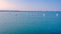 Sailing boats off coast compete in regatta