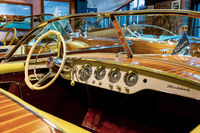 Istanbul, Turkey, 23 March 2019: Interior of vintage motor nautical boat Riva. Steering wheel of classic boat small motor sail wood rudder. Vessel drive control