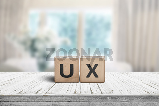 UX development sign on a table in a bright room