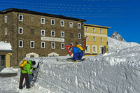 Skiers at the Bernina Hotel, Bernina pass, Engadin, Grisons, Switzerland