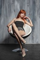 Nice lady posing sitting on a chair