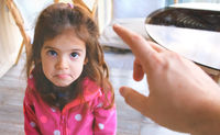 parent hand yelling blaming and scolding child reproaching baby girl daughter