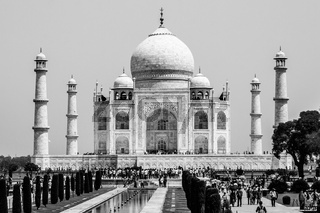 Silhouette of Taj Mahal with garden square, reflecting pool and visitors. UNESCO World Heritage in Agra, Uttar Pradesh, India
