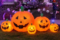 Inflatable pumpkins glowing.