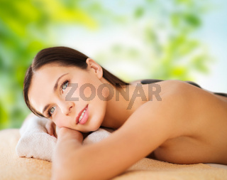 beautiful woman having hot stone therapy at spa