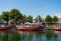 The view of the berths for ships and the historic quarter of Rostock - Warnemuende.