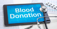 The word Blood Donation on the display of a tablet