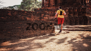 Man with Prosthetic Leg Traveling Walking Ruins
