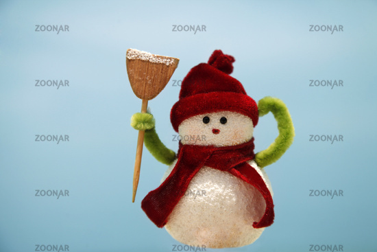 Toy of the snowman on blue background