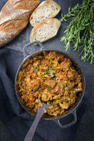 Traditional Polish kraut stew bigos with sausage