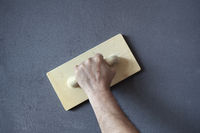 Plastering and Smoothing of a Wall