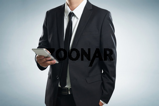 Close up of a businessman man using mobile smart phone