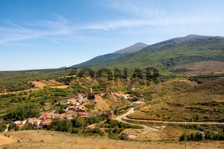 Aerial picture of medieval Aragon village of Vozmediano and castle ruins with Moncayo mountains in the background.