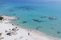 White dream beach with turquoise sea and crystal clear water from above on Sardegna, Italy