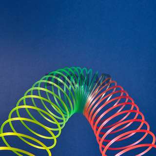 Geometric parabola from colored slinky toy.