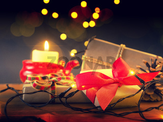 Magical Christmas background with gift boxes and candle