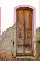 Old wooden door in colonial style aged house