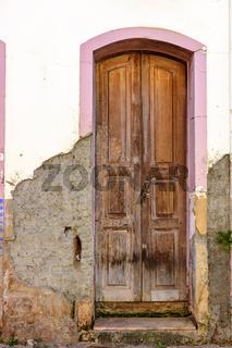 Old wooden door in colonial mansion
