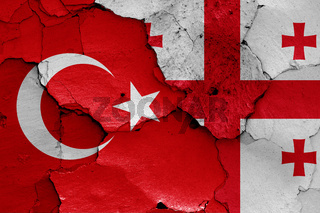 flags of Turkey and Georgia painted on cracked wall