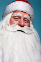 Close-up christmas face portrait of russiad Santa Claus Ded Moroz looking ironically at the camera.