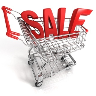 Red shopping cart with sale sign