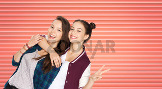 teenage girls or friends hugging and showing peace