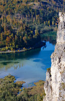 View from up to autumn Alps mountain lake with clear transparent water and reflections. Almsee lake, Upper Austria.