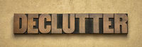 declutter word  abstract in wood type