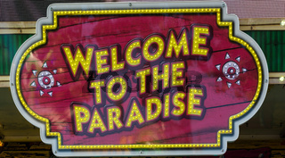 Welcome to the Paradise Sign Message Neon Festival Stand Closeup