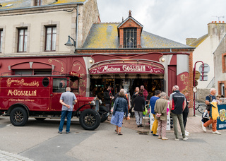 tourists visiting and crowding around the historic Maison Gosselin store in Saint-Bvaast-la-Hougue