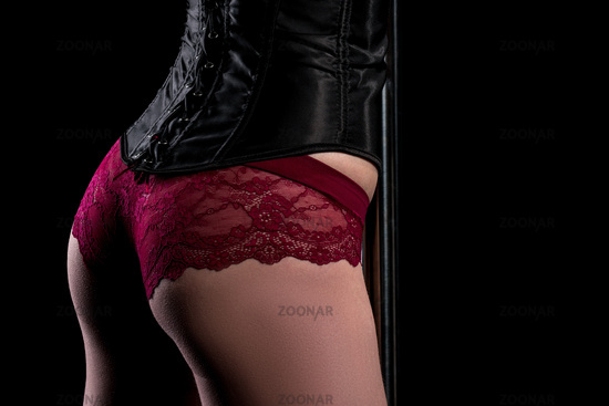 Woman in leather vest worn over lace underwear