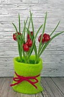 Spring red tulips on wooden background