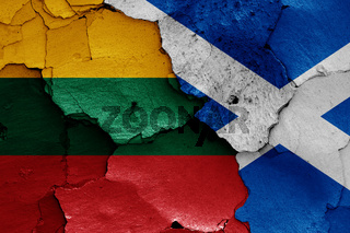flags of Lithuania and Scotland painted on cracked wall